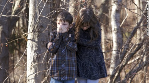 Children wait outside Sandy Hook Elementary School in Newtown, Connecticut, after the shooting. Photo: CNN