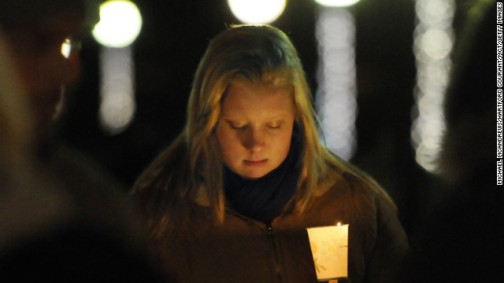 Corinne McLaughlin, a student at the University of Hartford, bows her head during a candlelight vigil at Hartford, Connecticut's Bushnell Park on Friday, December 14, honoring the students and teachers who died at Sandy Hook Elementary School in nearby Newtown earlier in the day. Twenty-seven people are dead, including 20 children, after a deadly shooting rampage. Photo by CNN