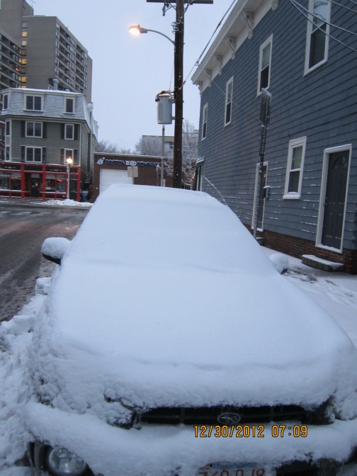 Snow is hiding my landlord's car in front of the apartment. Photo by Mai Ngoc Chau