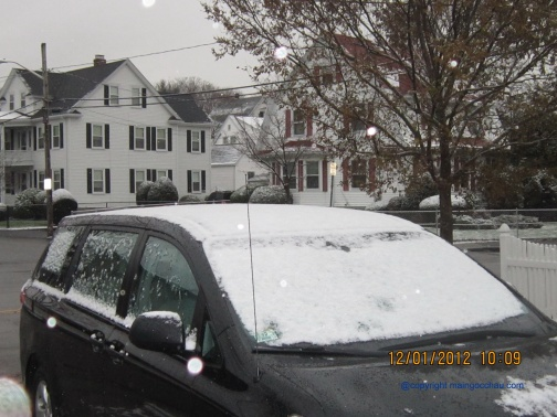 The snow is whitening my landlord's car.