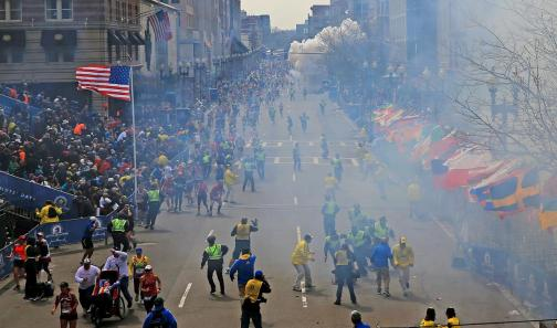 People reacted after a bombing near the finish line at the Boston Marathon
