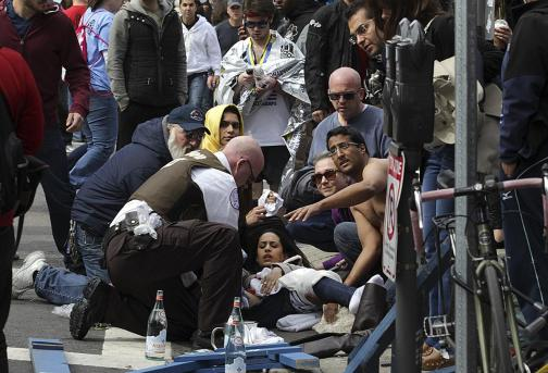 A woman was taken to a stretcher after the bombing. David L. Ryan/Globe Staff