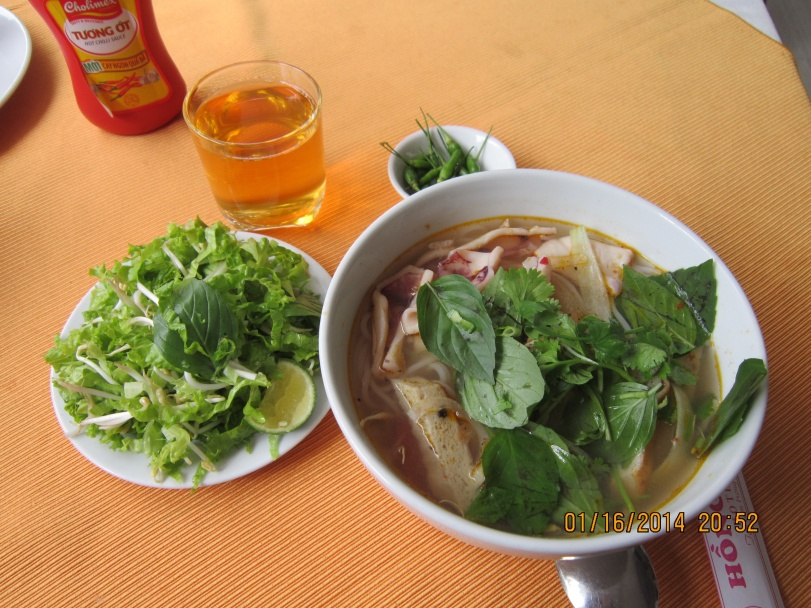 My first breakfast in Tuy Hoa with bún mực  (squid soup with rice vermicelli). Photo: Mai Ngoc Chau